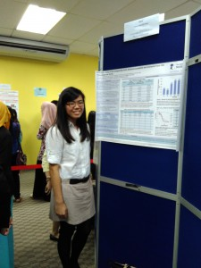 Tan Hui Woon with her poster detailing her findings.