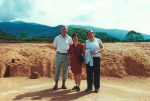 Photograph of Bob Oldroyd, Khan and Lynne Tucker standing on the site of the future Malaysia campus of the University of Nottingham