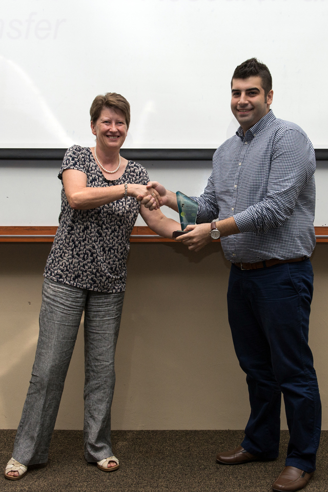 Professor Christine Ennew presenting Reza with the UNMC 3MT overall winner prize
