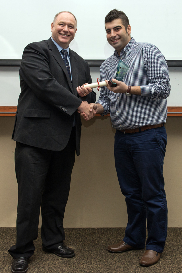Professor Graham Kendall presenting Reza with the People's Choice award